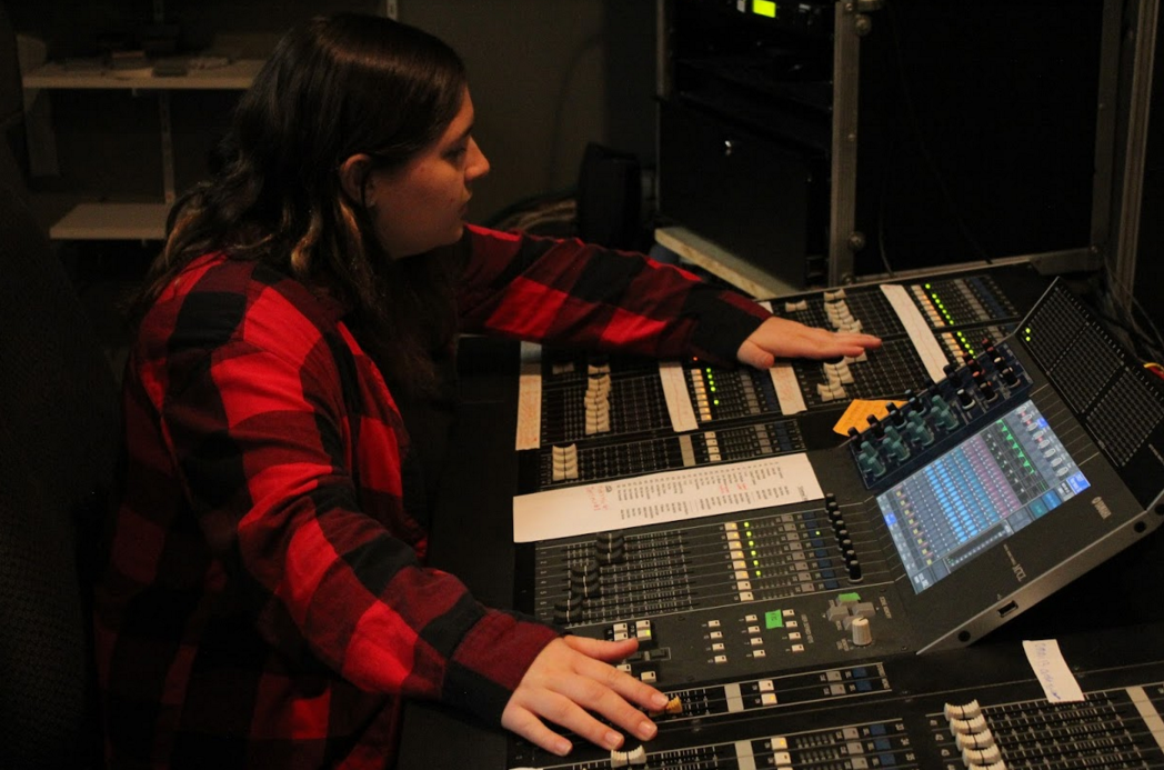 Senior Miranda Madden runs the sound booth for the upcoming show