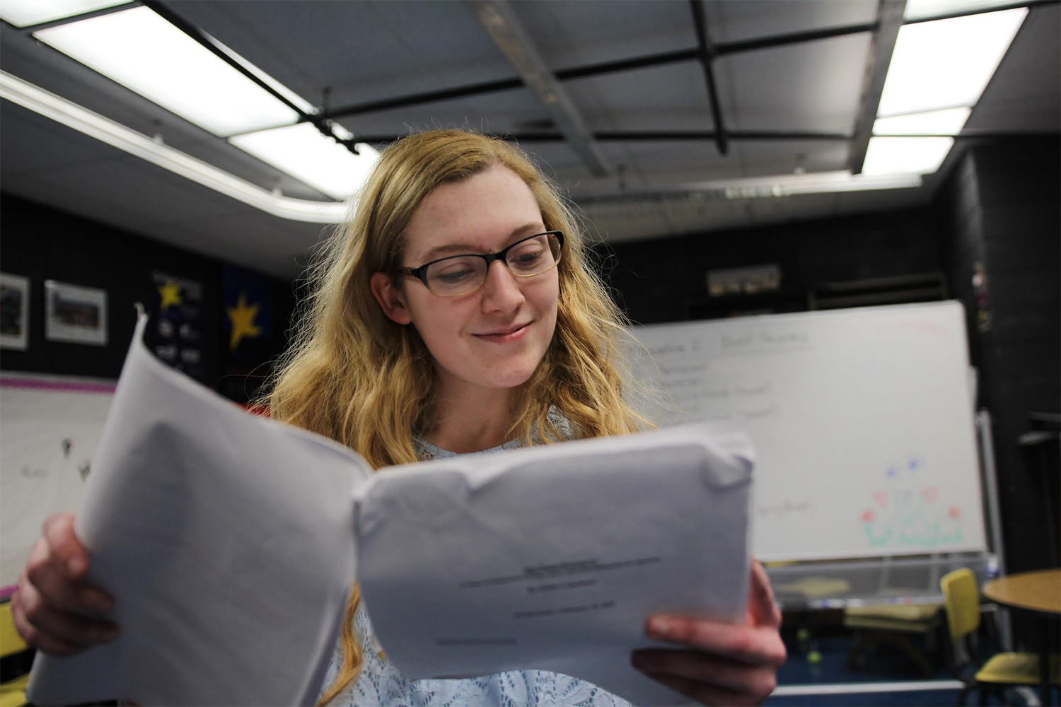 Cassie Hurt-McLarty reads her script for the Social Issues play.