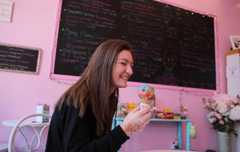 Junior Maddy Robison eats multi-flavored ice cream at Sugar Rush.