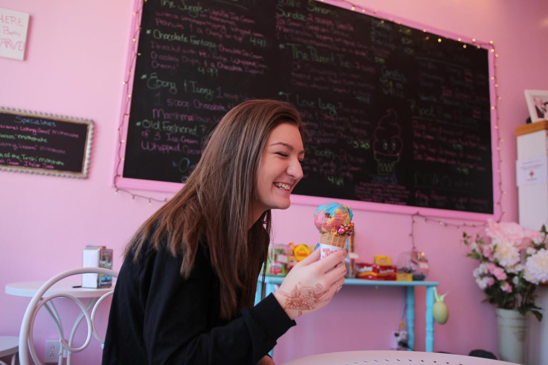 Junior Maddy Robison eats multi-flavored ice cream at Sugar Rush.