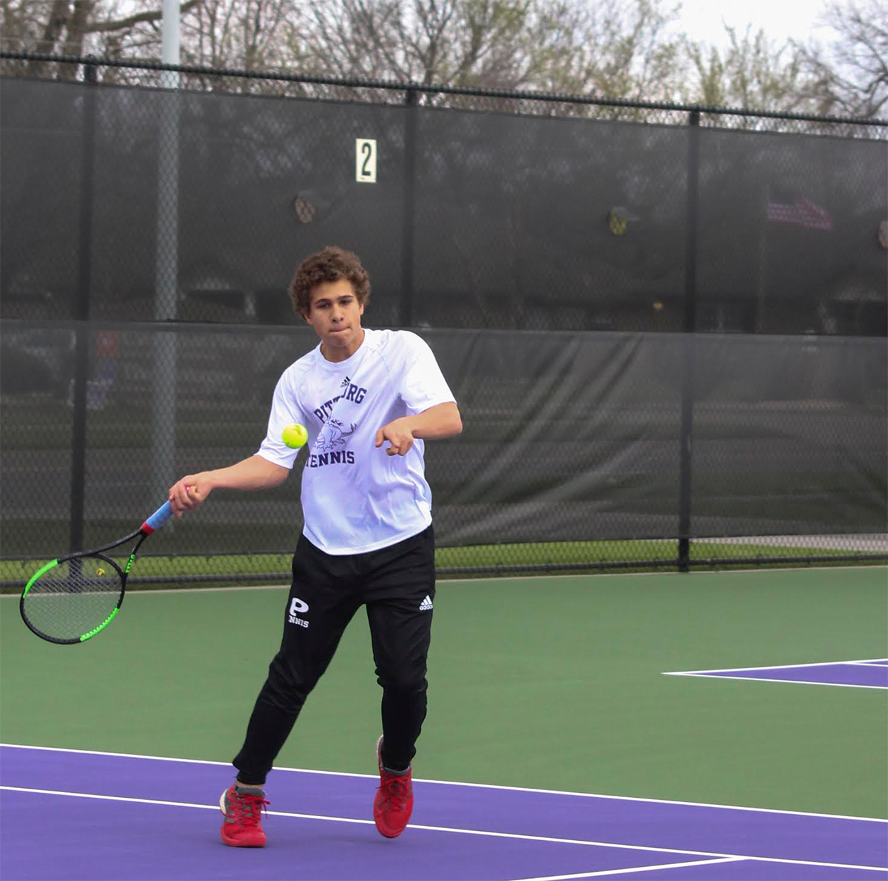 Sophomore Dakota Caudle returns a serve during his singles match against Chanute.