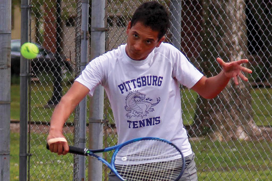 Junior Devin McAfee slices the ball back to his opponent. McAfee has been playing tennis since he was young, and this is his third time competing at the State Tennis Tournament.