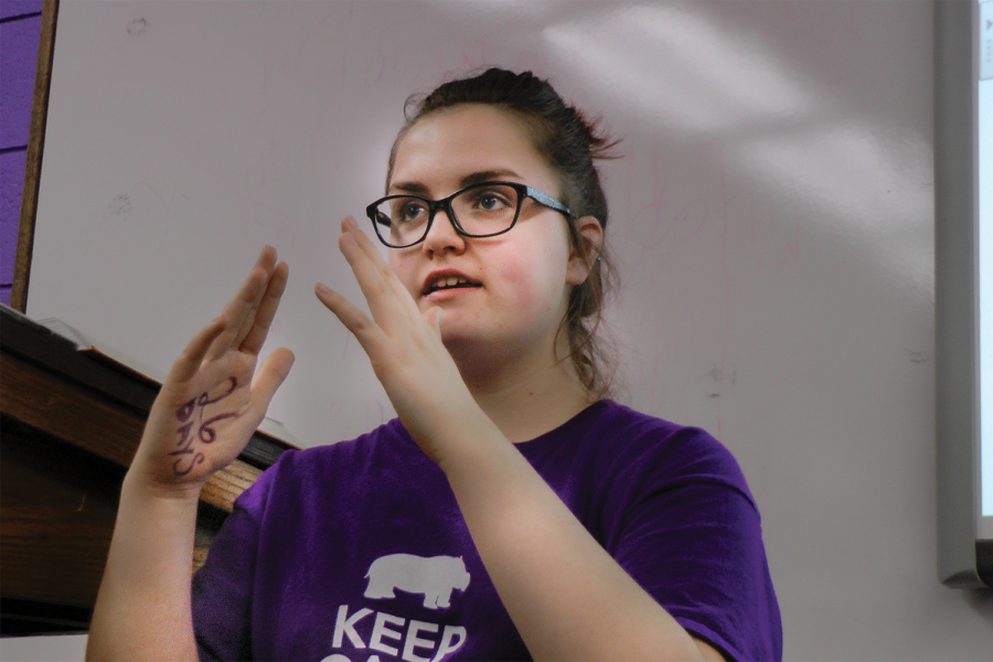 Freshman Emily Wachter teaches a word from American Sign Language (ASL) to the ASL Club during heir meeting last Wednesday after school.