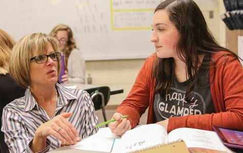 Sophomore Scout Peery listens as Rhonda Willis guides her through her honors algebra II homework.