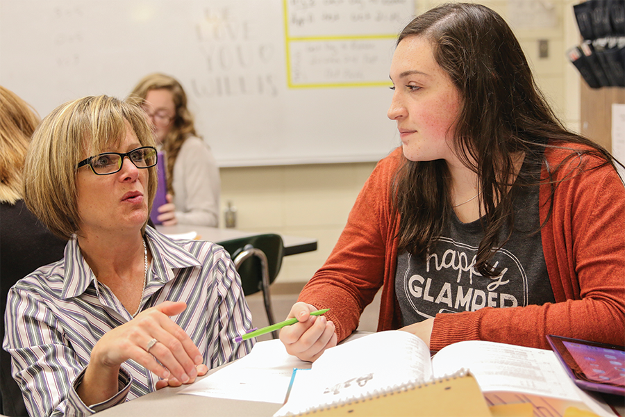 Sophomore Scout Peery listens as Rhonda Willis guides her through her honors algebra II homework.
