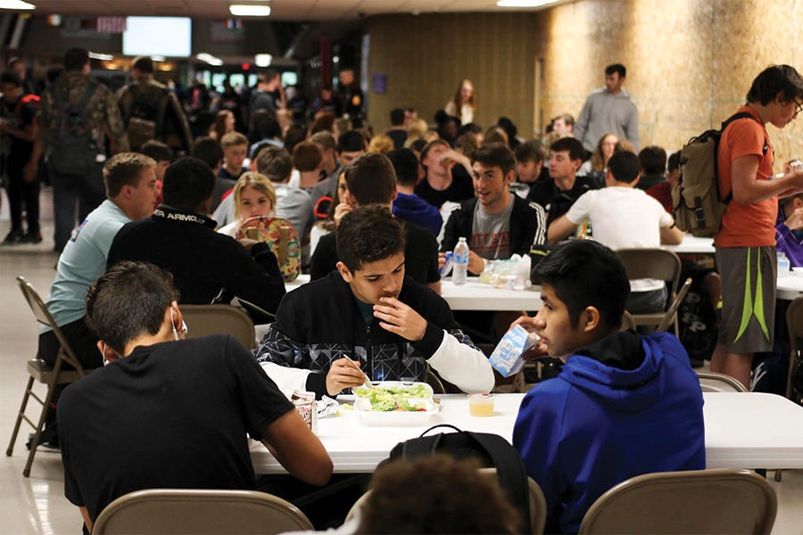 Students eat lunch at tables set up specifically for Power Hour. Students have a 50-minute break to eat lunch and meet with teachers.