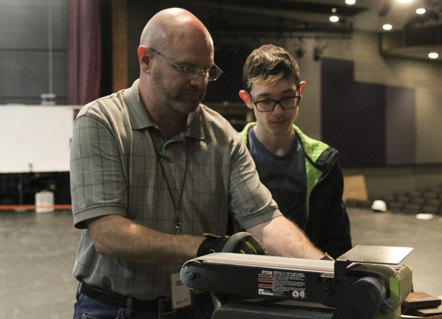Chuck Boyles helps sophomore Cole Ingerson create a prop as a class project. While this is Boyles first year teaching a class, he has been helping behind the stage at PHS for four years.