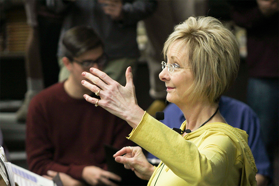 Vocal music director Susan Laushman accompanies and conducts during a Multigenerational Choir rehearsal. Laushman has been teaching music for 30 years.