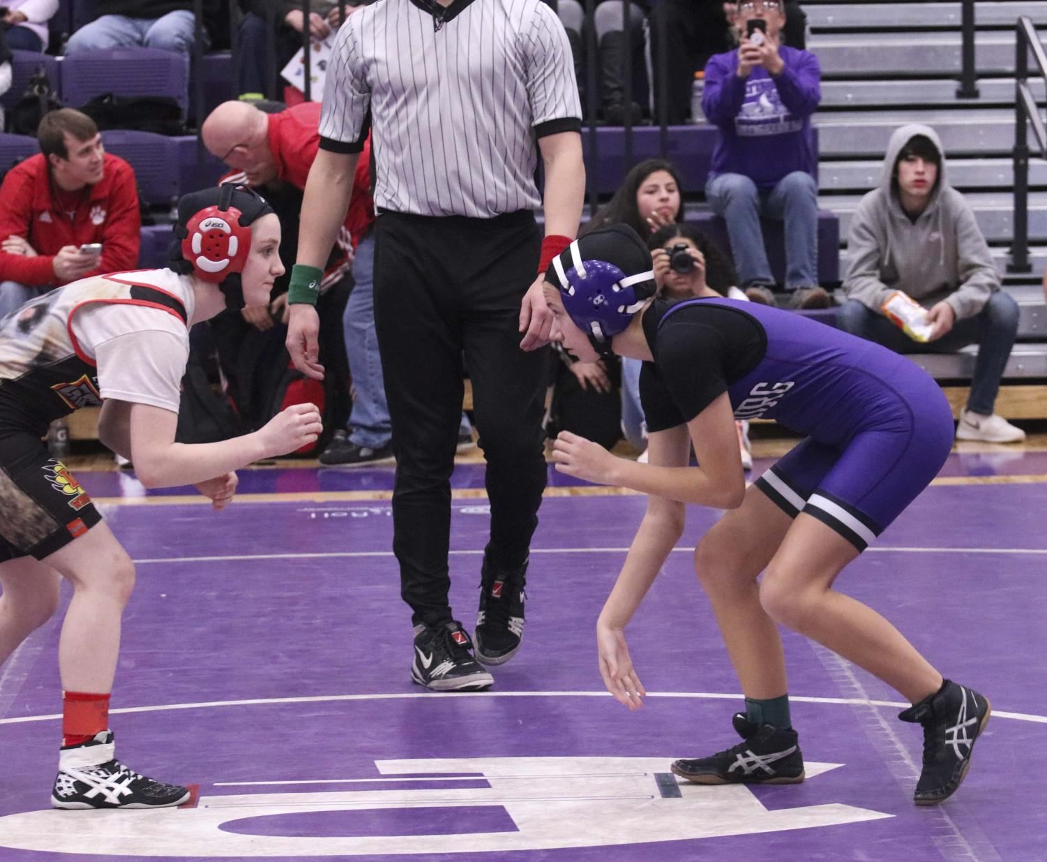Sophomore Rebeccah Jones (right) — the only girl on the PHS wrestling team — takes on Labette County at PHS's first annual home Southeast Kansas JV Wrestling Championship. Jones went 1-2, placing second in the tournament's all-girls, 100-104 pound weight class.