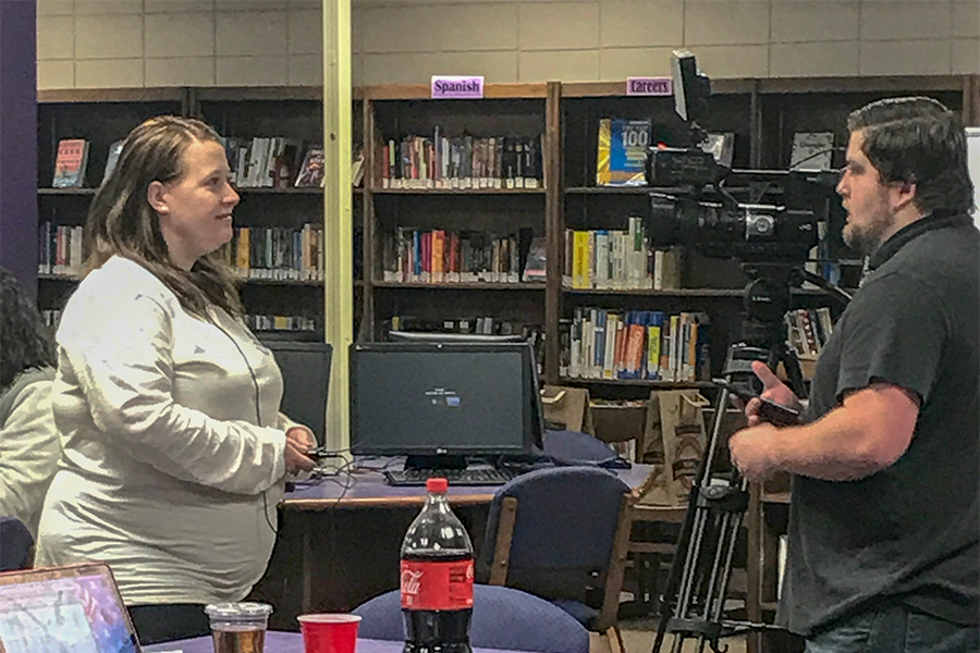 Head debate and forensics coach Julie Laflen responds to interview questions from a local television station at the team's annual home tournament. This year's student-run tournament was the largest in school history, with over 300 competitors from 21 different schools.