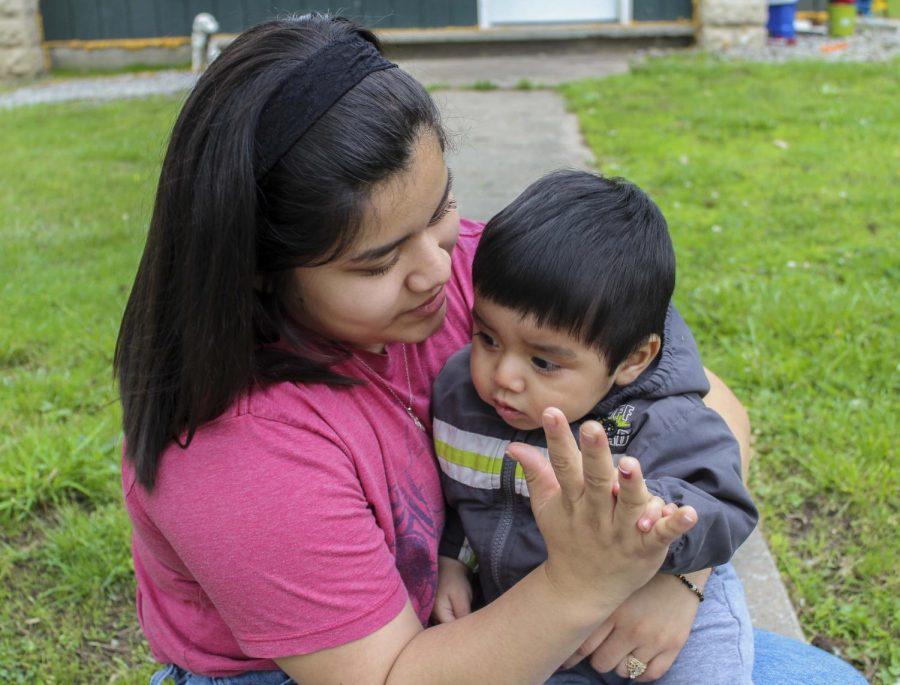 Junior Neira Garcia spends time with her son, Daniel, after school. Daniel was born in June.