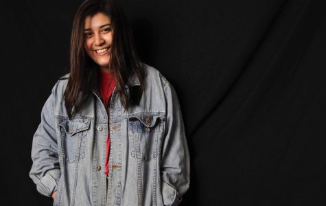 Abarca models her thrifted vintage jean jacket. Photo by Cassidy Bayliss