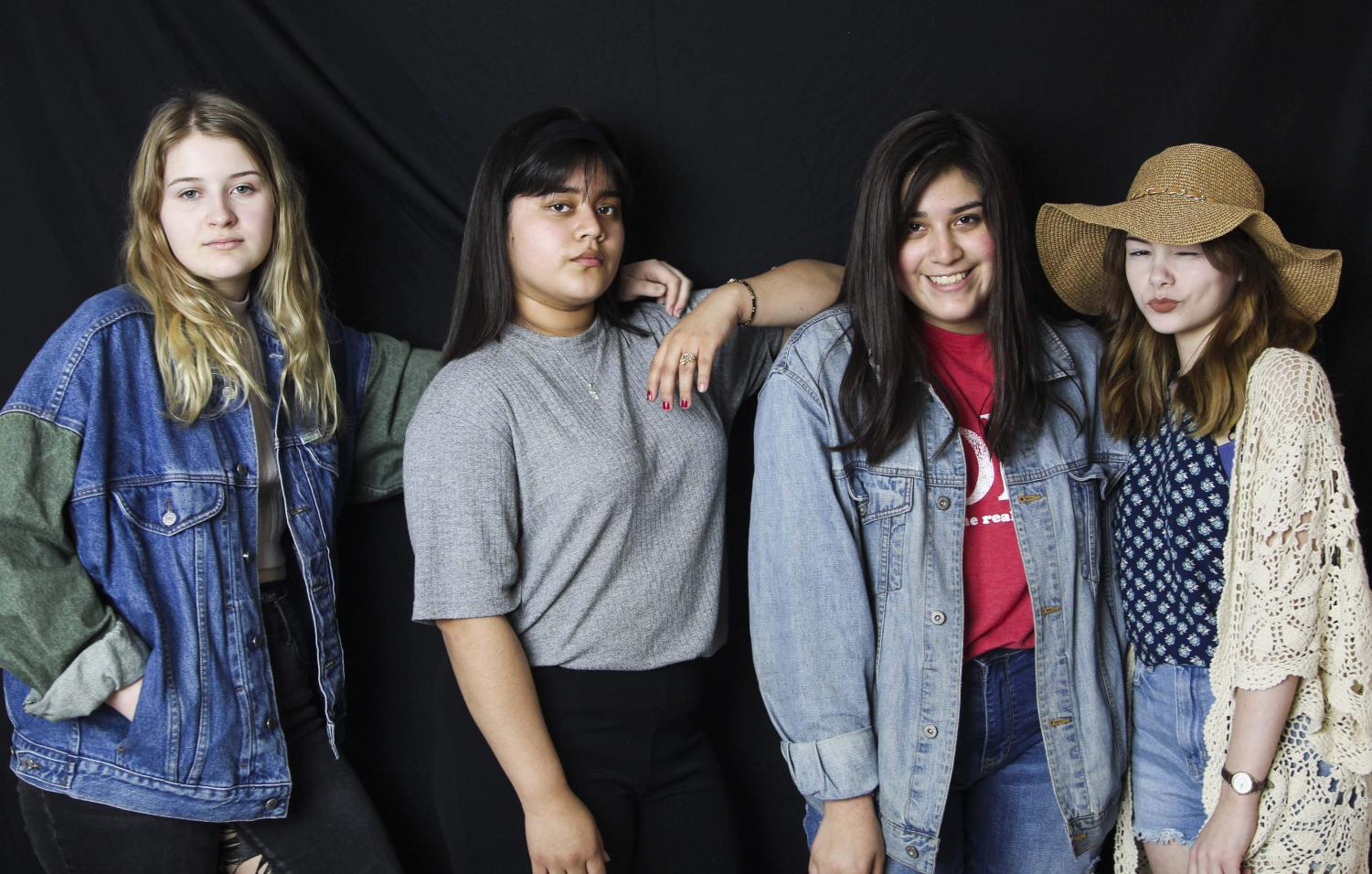 Showing off their favorite thrifted outfits sophomore Rose Scott, junior Neira Garcia, sophomore Hannah Abarca and junior Taylor Culbertson pose for the camera.