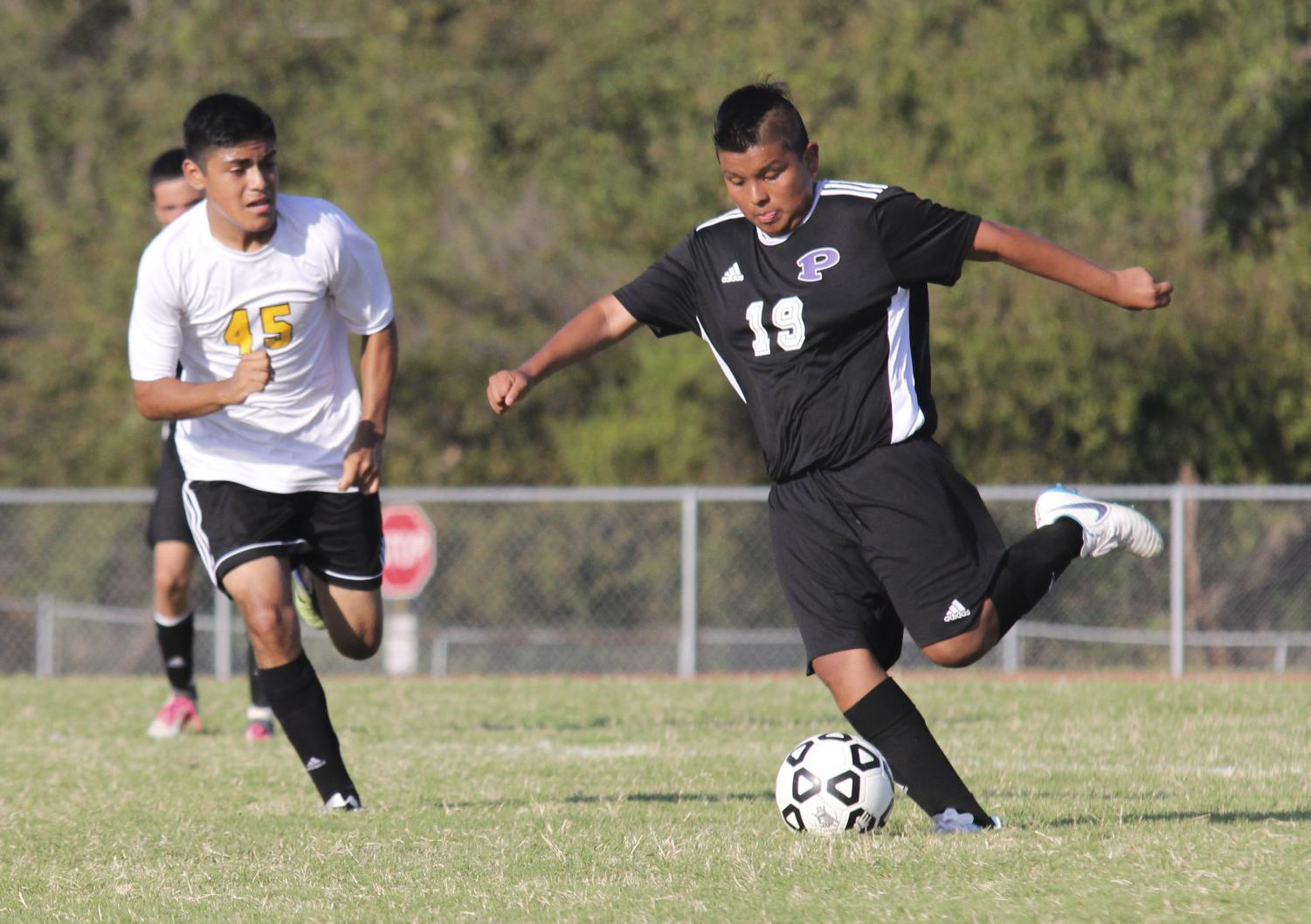 Sophomore Jeremy Perez takes on an defender against Coffeyville on Sept. 13, 2018 during a jv game. PHOTO BY ROSS LAIDLER