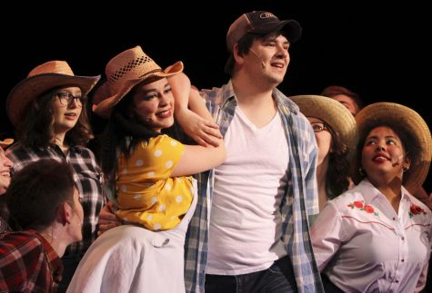 "Seniors McKenna Shaw and Gabriel Anderson performing during the school play ""Footloose."""
