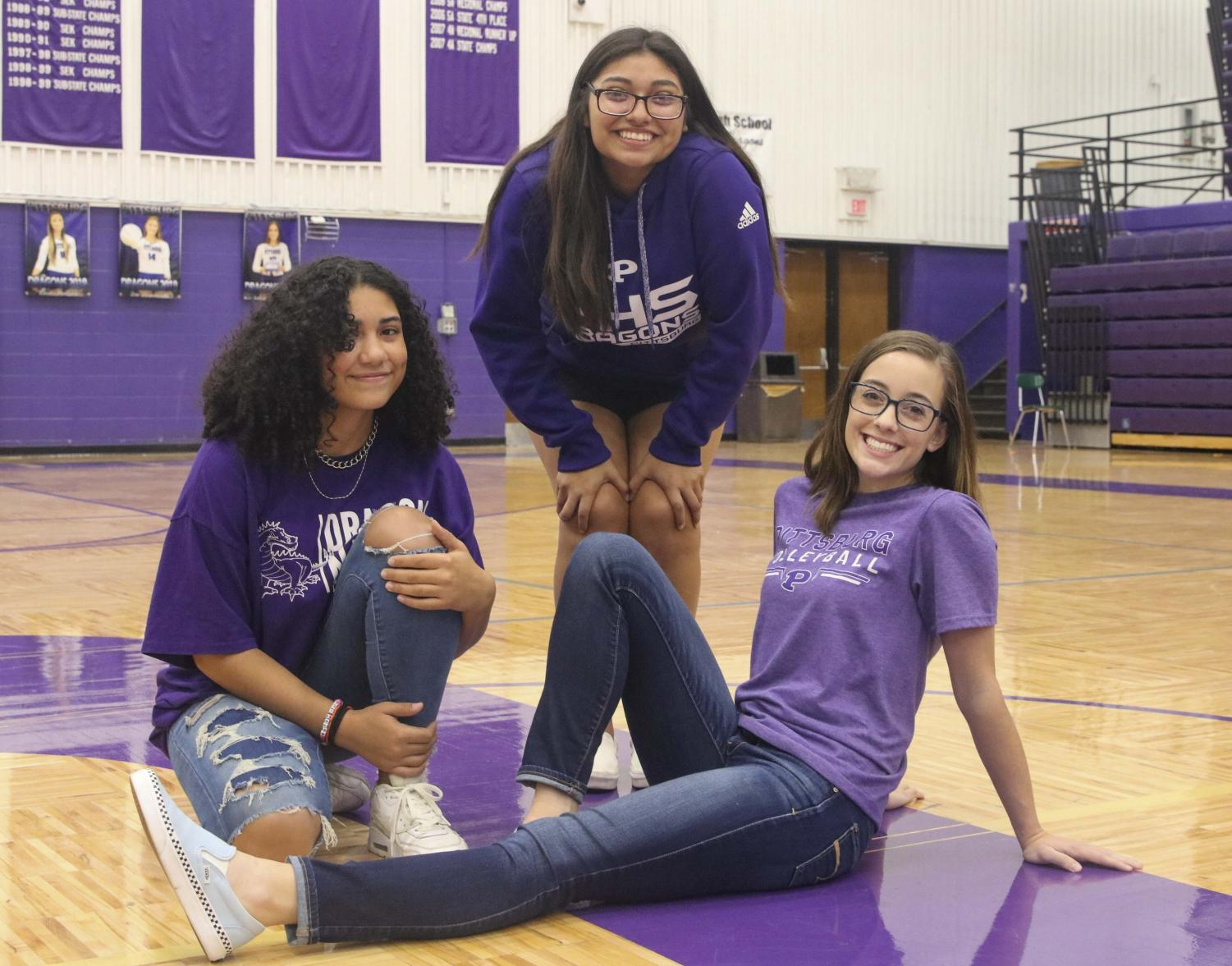 Female athletes Shi Ross, Daphine Samayoa and Natalie Talent are members of the first all-girls soccer team. PHS is also adding girls wrestling.