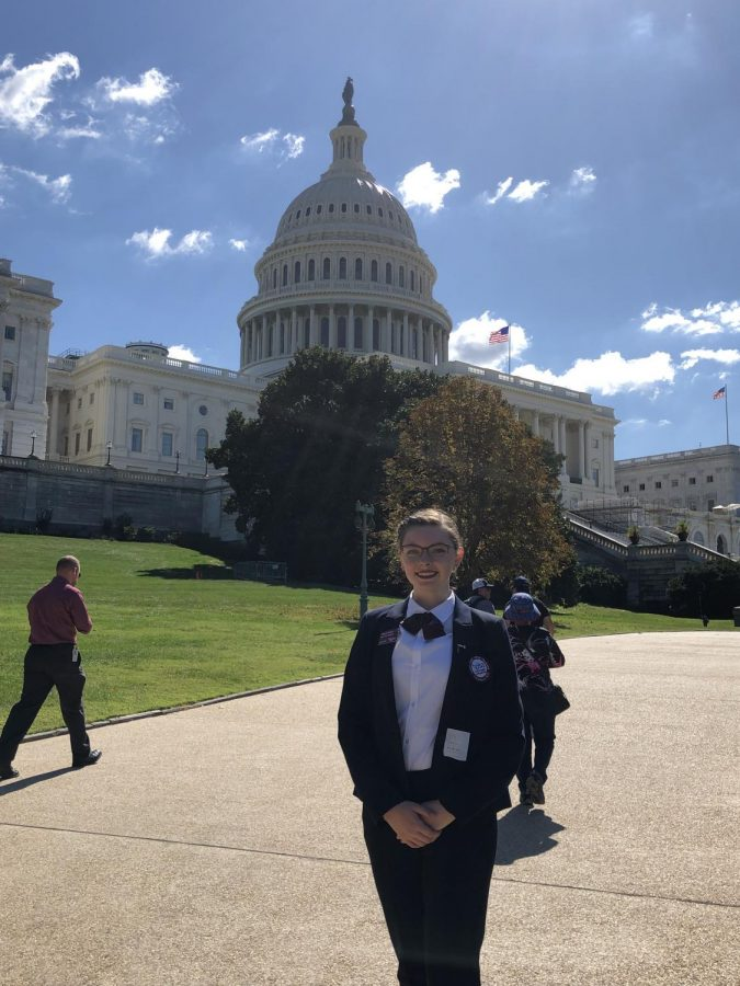 Senior Mikayla Kitchen stands in her HOSA uniform in front of the Capitol building. Kitchen attended the conference Sept. 19-24 after being invited because of her position as Vice President of Kansas HOSA.