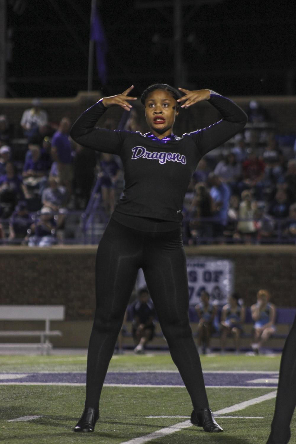 Junior I'sis Thomas dances on the halftime field during the halftime show on Oct. 19