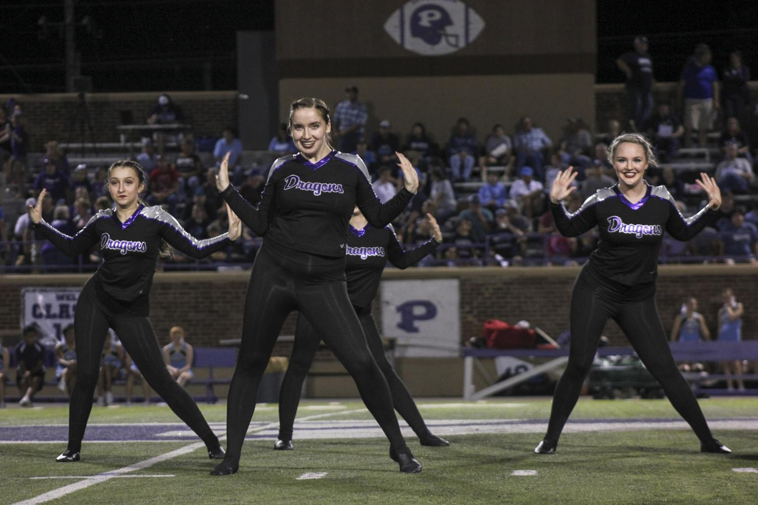 Members of the dance team perform on Sept. 13 during halftime of the varsity football game.