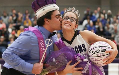 Junior Chris Saman kisses junior Natalie Talent for the Winter homecoming ceremony.