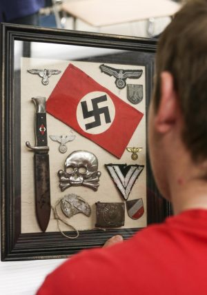 Bringing history alive: students gain hands-on experience from teacher's personal collection