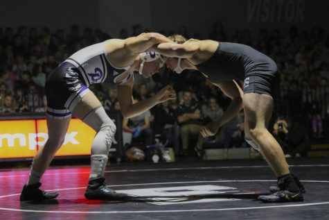 Senior Jesse Stover wrestled Frontenac's Storm Niegsch on Jan. 16 at the Crosstown Throwdown hosted by Frontenac.