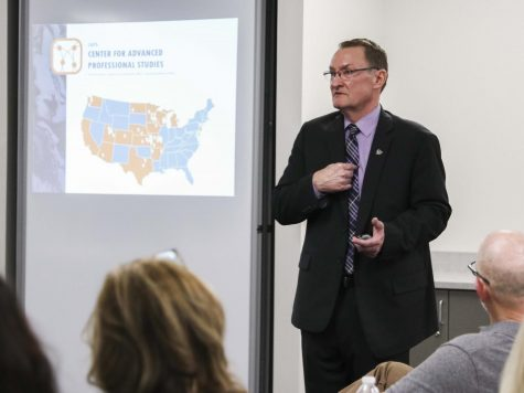 Dr. Brad Hanson, assistant superintendent, gave a presentation on a new educational program called Capitals Advanced Personal Studies, also known as CAPS, to local businesses in the community.