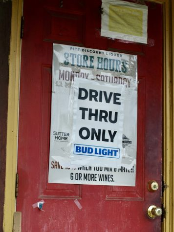 Photo credit: Ashlan Brooks. Sign posted on the outside of Pitt Discount Liquor