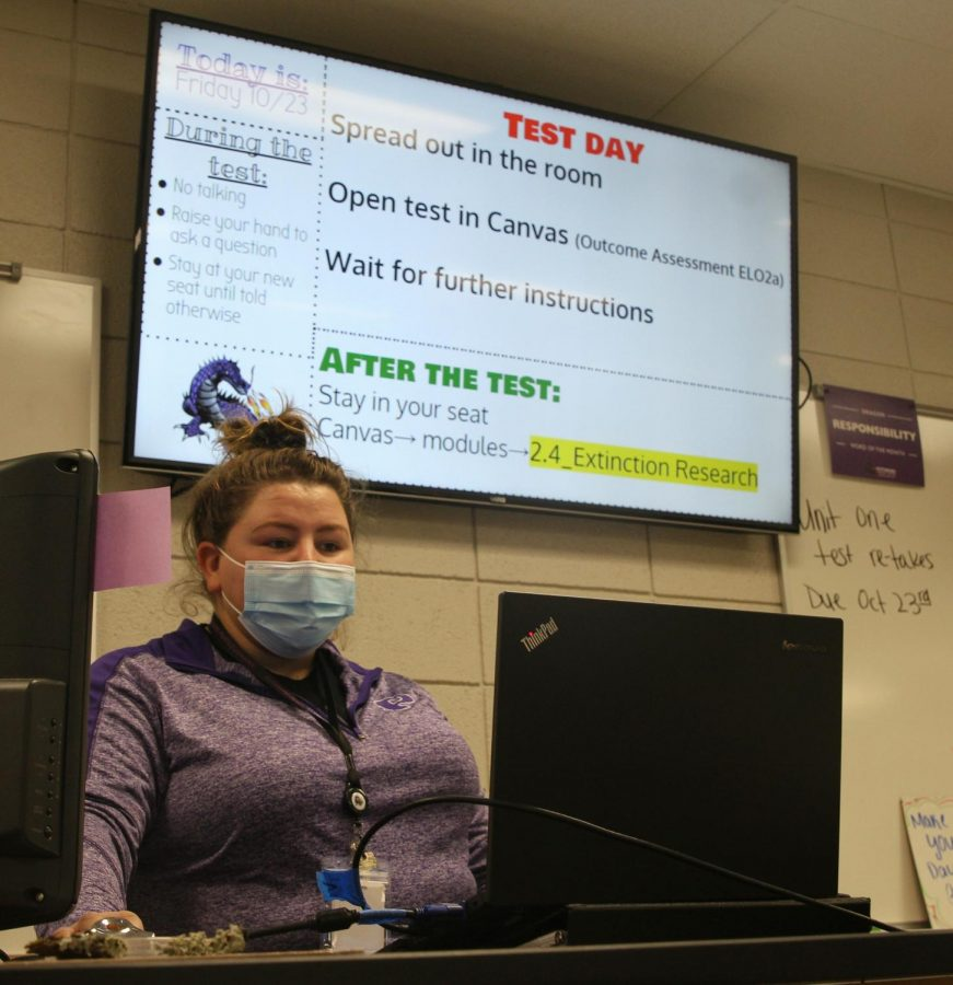 Science teacher Aubry Ross prepares for the day by checking her slideshow.