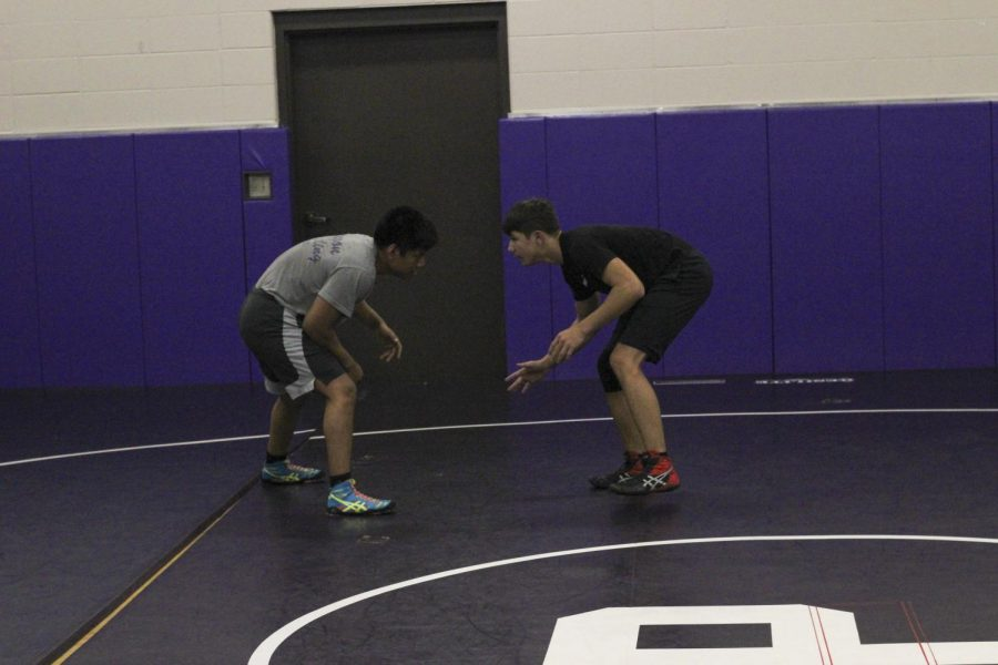 Alex Averado (left) practicing mid level takedowns on his partner Corbin McIntier (right) on Tuesday Oct.13th at open mat.