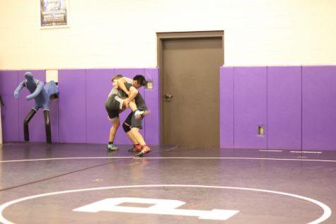 Preparing for the takedown: wrestlers train for season