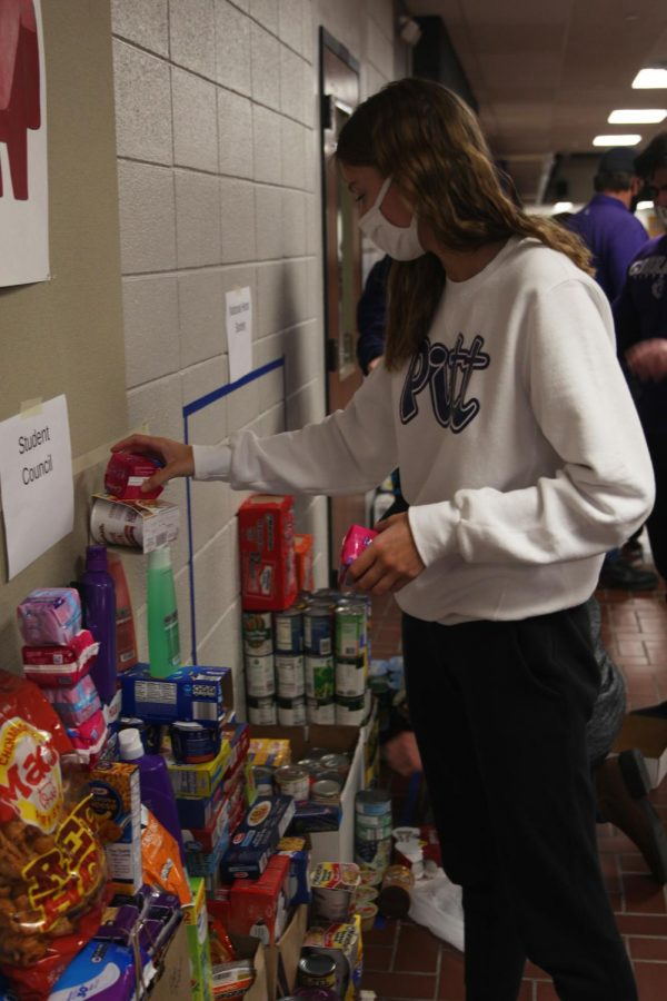 Junior Abby Painter stacks hygiene products.