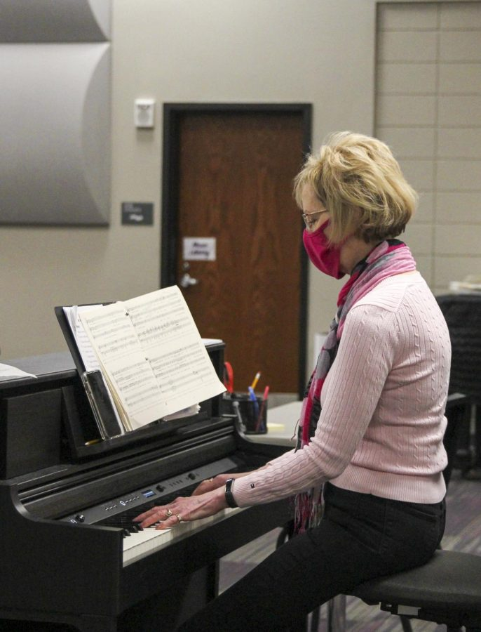 Music teacher Susan Laushman plays a piano piece for her students.