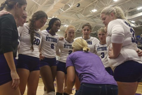 Coach Ashlan Schwartz talks to the Varsity volleyball team during a game.