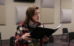 Senior Dallas Cox rehearses his solo for vocal music director Susan Laushman. Cox selected a Russian folk song.