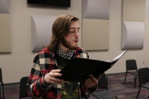 Senior Dallas Cox rehearses his solo for vocal music director Susan Laushman. Cox selected a Russian folk song.