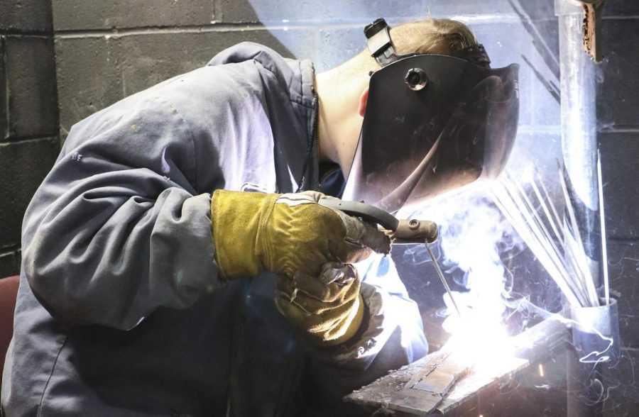 Senior Zane Decker completes a weld at the welding class at CTEC