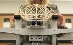 Sally Ricker demonstrates physics class project by building a bridge