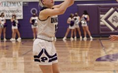 Senior Madden Petty shooting against the Chanute Comets.