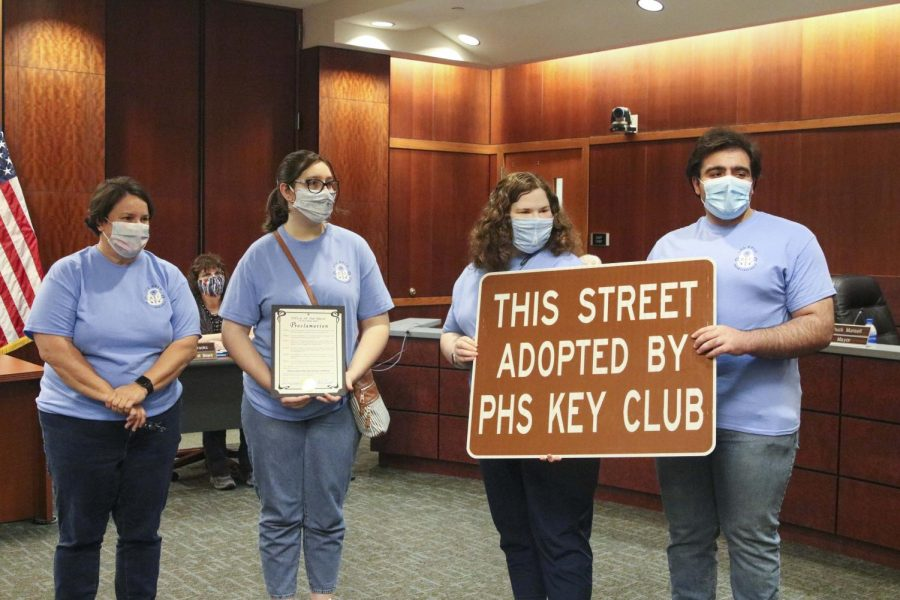 Key Club Advisor Kristin Thomas stands with club officers Corin Cooper, Elliot DeGruson, and Chris Saman to accept an adopted highway from the County Commissioner's office.