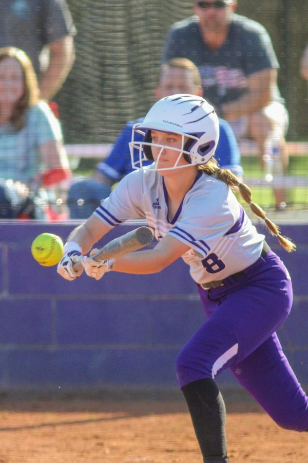 Junior Molly Garzone bunts the ball during a game against Riverton.