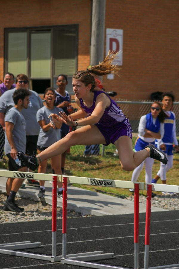 Senior Sarah Stebbins competes in the 300m hurdles at the varsity Columbus meet on Tuesday, April 20th.