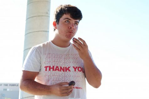 """Photo Caption: Senior Dakota Reese focuses on eating his donuts during the donut eating competition. """"I wouldn't recommend watered down donuts to anyone."""" Reese said."""