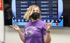 Spanish teacher Jessica Mildfelt starts to show instructions for chardes.