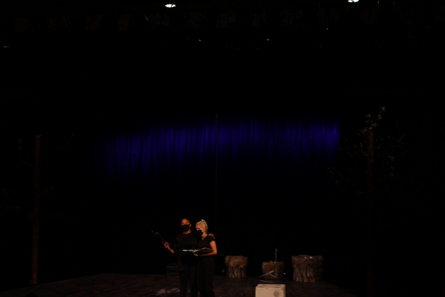 Aunyx Estes(on the left) and  Mallory Womeldorff(on the right) on stage during a light test.